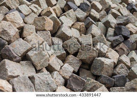 Background with pile of cubic stones for paving - stock photo