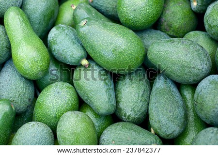 background with ripe avocado - stock photo