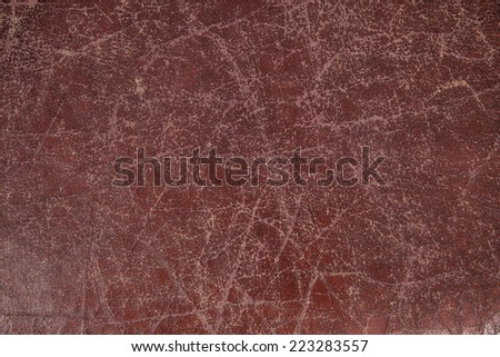 background with scratched ox blood red leather closeup - stock photo