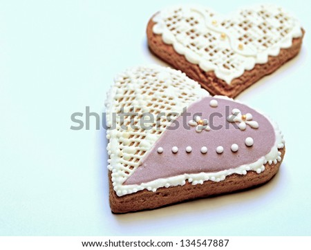 background with sugar glaze decorated gingerbread hearts - stock photo