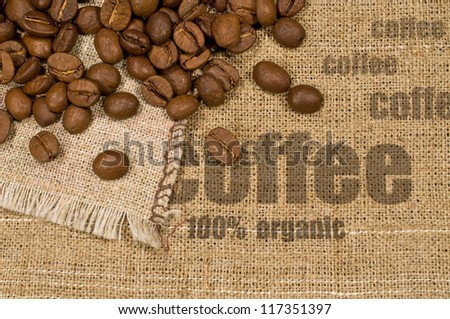 "background with texture of burlap , the words "" coffee"" and coffee beans - stock photo"