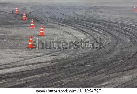 Background with traffic cone on road track - stock photo