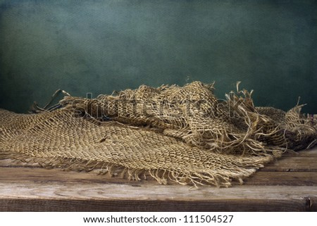 Background with wooden deck table and mesh cloth - stock photo