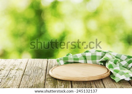 Background with wooden table with cutting board - stock photo