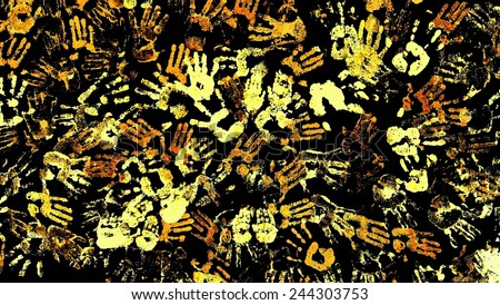 Background with yellow, gold traces of the hand on black wall. - stock photo