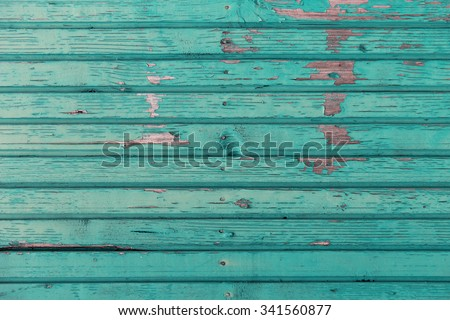 backgrounds and texture concept - old wooden fence painted in blue background - stock photo