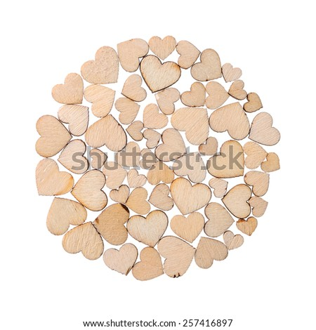 Backgrounds and textures: circle made of small wooden laser-cut hearts, isolated on white background - stock photo