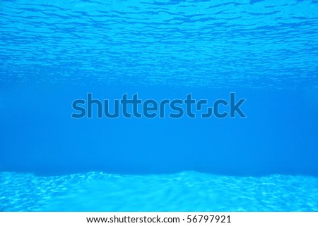 Backgrounds And Textures - Water - View under the water in a blue swimming pool. - stock photo