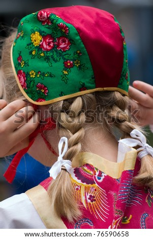 Backhead of Swedish girl in a traditional Swedish national costume, Celebrating midsummer - stock photo