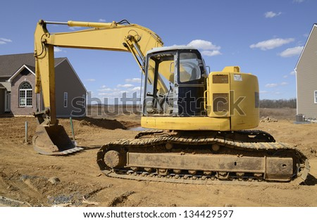 backhoe, a type of heavy duty construction equipment used in excavation - stock photo