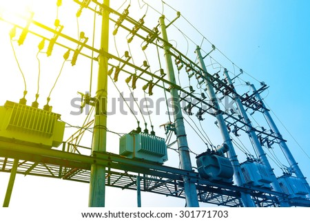 backlighting of a group of power transformer   - stock photo