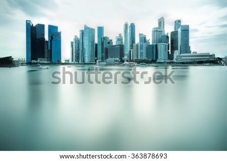 Backlit city skyline - stock photo