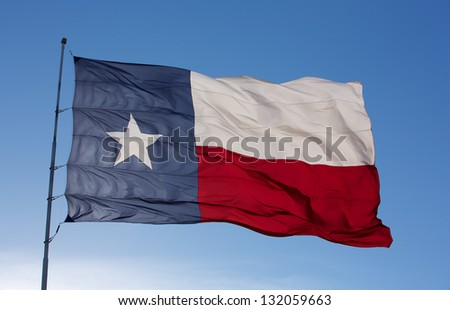 Backlit close up of the State Flag of Texas - stock photo