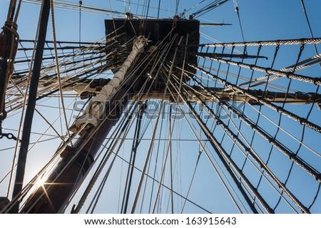 backlit mainmast of replica ship - stock photo