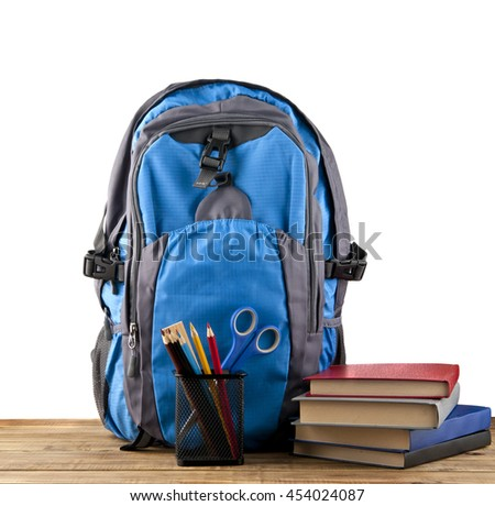 backpack, books and stationery for school isolated on a white background - stock photo