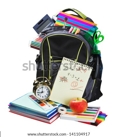 Backpack full of school supplies on white background - stock photo