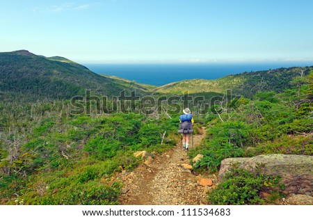 Backpacker hiking the Green Gardens trail in Gros Morne National park - stock photo