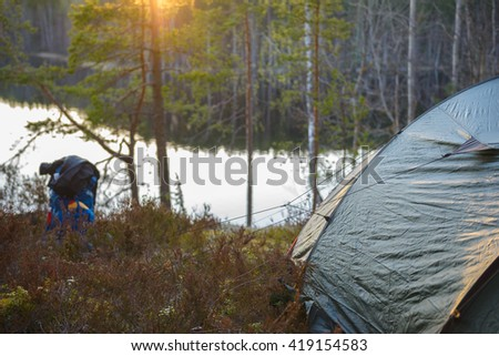 Backpacker's tent in the woods - stock photo