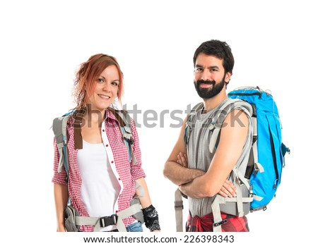 Backpackers making a deal over isolated white background - stock photo