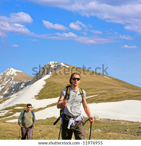 Backpackers on a mountain in Macedonia - stock photo
