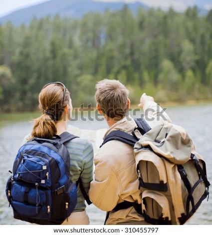 Backpacking people. Young trekking couple - stock photo