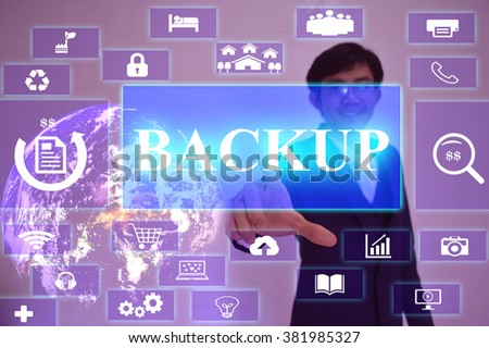 BACKUP concept  presented by  businessman touching on  virtual  screen ,image element furnished by NASA - stock photo