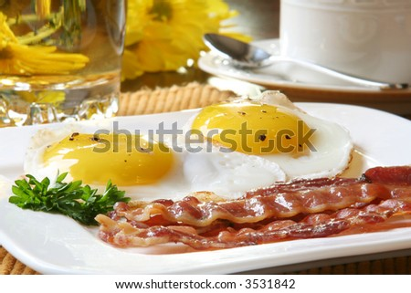 Bacon and eggs for breakfast - stock photo