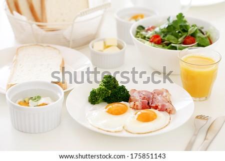 Bacon and eggs, well-balanced breakfast - stock photo