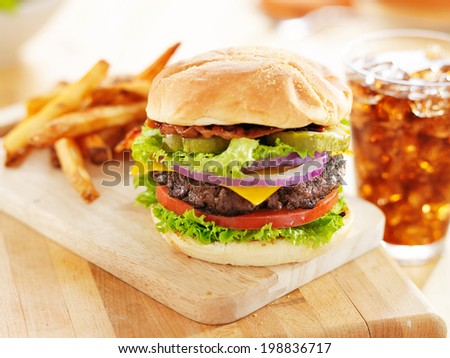 bacon cheeseburger with french fries and soft drink - stock photo