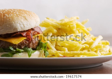 bacon cheeseburger with fries - stock photo