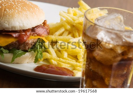 bacon cheeseburger with fries and coke - stock photo