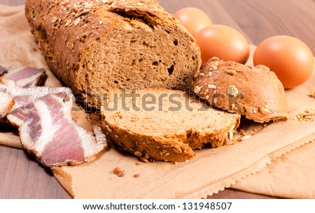 Bacon,egg and bread on the table. Selective focus on the bread - stock photo