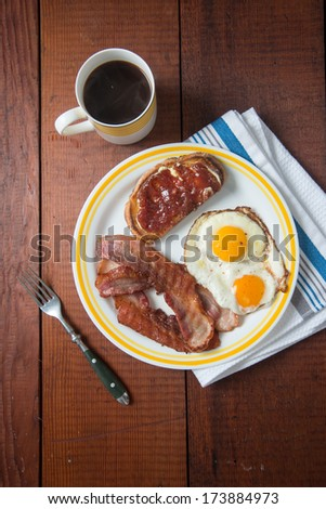 Bacon, Eggs, and Toast with Jam for Breakfast  - stock photo