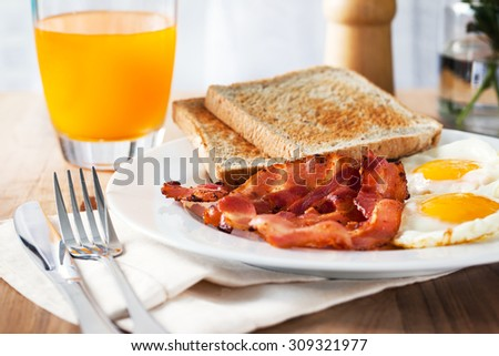 bacon,fried egg ,bread for breakfast - stock photo