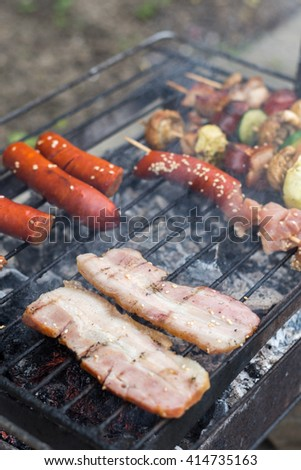 Bacon on the grill. - stock photo