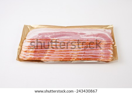 Bacon slices on the package, isolated on white background  - stock photo