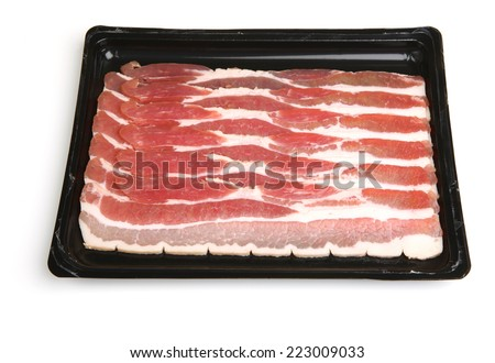 Bacon strips in plastic packaging tray - stock photo