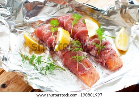 Bacon wrapped salmon - stock photo