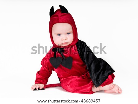 Bad baby boy in halloween outfit on isolated background - stock photo