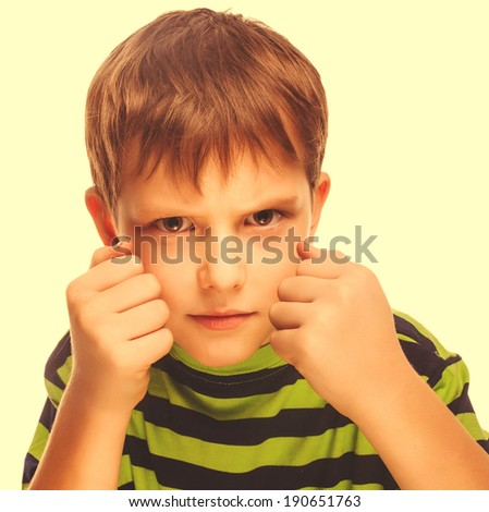 bad child boy blond bully angry aggressive fights in striped green shirt isolated on white background large cross processing retro - stock photo