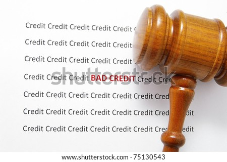 bad credit text( bankruptcy ) and legal gavel - stock photo