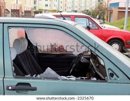 bad day for owner car - vandal or thief or accident - destroyed window-pane, - stock photo
