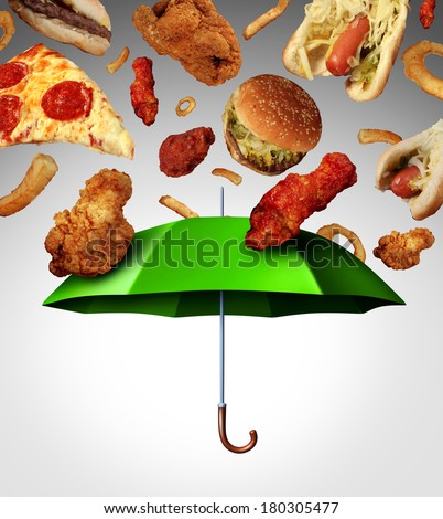 Bad diet protection food concept  with a group of greasy fatty fast food  falling down like rain and a green umbrella stopping the unhealthy food as a metaphor for poor nutrition and eating habits. - stock photo