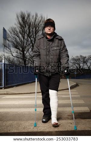 Bad emotions of injured man - stock photo