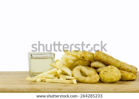 Bad fats (sunflower oil, french fries and fried food) - stock photo