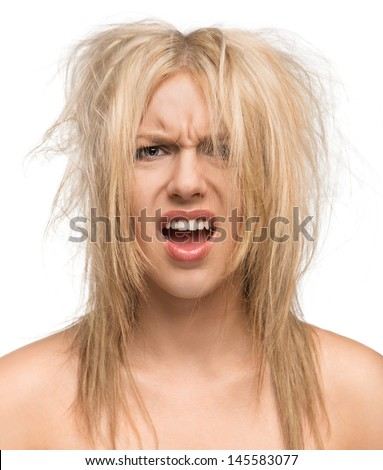 Bad hair day, portrait of a beautiful girl with messed up hair isolated on white background - stock photo
