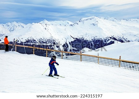 BAD HOFGASTEIN, AUSTRIA - JANUARY 09, 2013: Unidentified young skier enjoy skiing at the slope in the Austrian Alps, during the winter vacation, on famous ski resort Bad Hofgastein, Austria. - stock photo