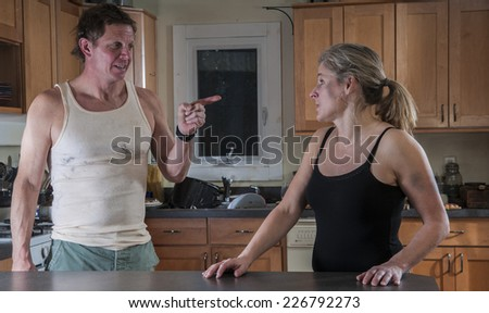 Bad relationship: bruised/battered woman with hostile/threatening man - stock photo