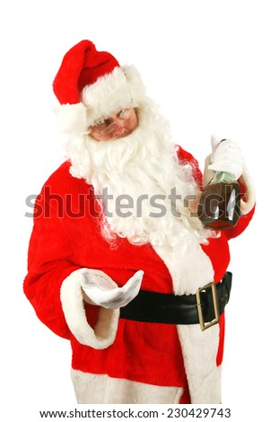 Bad Santa. Santa Claus has been a Bad Bad Boy this season. Some nice person left him a bottle of Brandy as a thank you gift for Christmas and he drank the whole bottle at once. Santa loves Brandy - stock photo