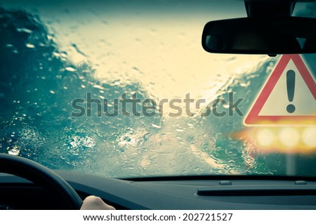 Bad weather driving - Caution - stock photo